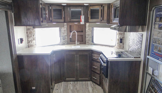 To learn more about travel trailers, view the spacious interior of a Keystone Bullet